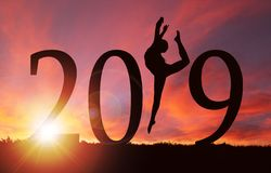 2019 New Year Silhouette of Girl Dancing at Golden Sunrise stock photo