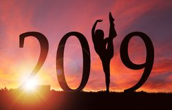 2019 New Year Silhouette of Girl Dancing at Golden Sunrise royalty free stock images