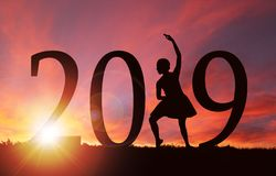 2019 New Year Silhouette of Girl Dancing at Golden Sunrise royalty free stock photo