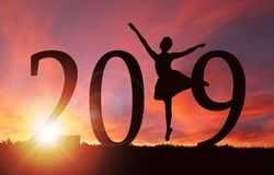 2019 New Year Silhouette of Girl Dancing at Golden Sunrise stock images