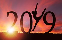 2019 New Year Silhouette of Girl Dancing at Golden Sunrise stock photography