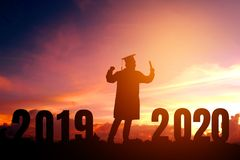 2020 New year Silhouette young man graduation in 2020 years education congratulation concept ,Freedom and Happy new year.  royalty free stock photography