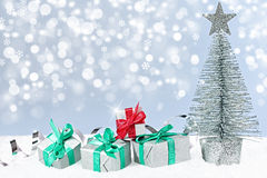 New Year 2015. Silver Christmas tree with gifts on snow Royalty Free Stock Image