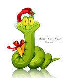New year snake. Snake. Symbol of new 2013 year. With gift and in christmas cap Stock Photography