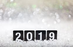 2019, new year on snow, abstract bokeh lights background. Copy space stock photography