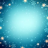 New year snow blue abstract empty background. Snowflakes and sparkles frame. Holiday magic background. Christmas blue texture. Royalty Free Stock Images
