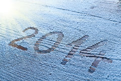 New Year 2014. New Year 2014 on snow-covered wooden desk Stock Images
