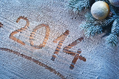 New Year 2014. New Year 2014 on snow-covered wooden desk Royalty Free Stock Image