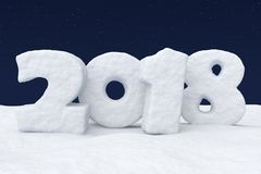 New Year 2018 snow text on snow under night sky with stars. New Year 2018 text written with numbers made of snow on the snowy field at night under cold north Royalty Free Stock Photos