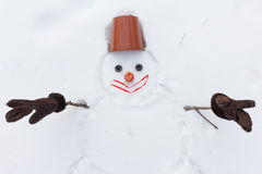 New year snowman instead of hands with gloves Royalty Free Stock Photo