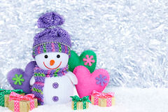 2015 New Year. Snowman with hearts, gift boxes on snow Stock Photo
