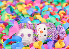 New Year 2015. Snowman relaxing on colorful serpentine Royalty Free Stock Photo