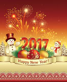 New Year 2017 with snowmen and balls. Postcard Happy New Year 2017 on a red background with fireworks Stock Photo