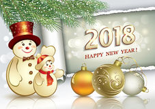New Year 2018.  Snowmen and date 2018 on a roll of paper under the spruce branches Royalty Free Stock Photo