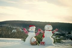 New Year Snowmen From Snow At Chimney. Royalty Free Stock Photography