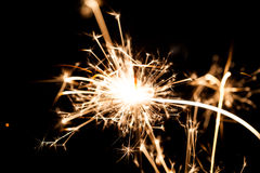 New Year sparkler on black background Stock Images