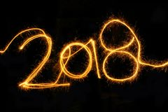 New Year 2018 sparkler on a black background Royalty Free Stock Photography