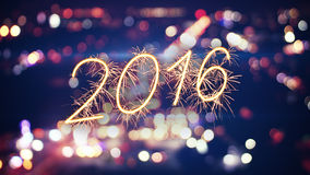 2016 new year sparkler text and city bokeh Royalty Free Stock Photo