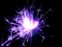 New Year with sparklers sparks on a black background Royalty Free Stock Photo