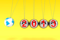 New Year Spheres of Newton. New Year concept. Spheres of Newton with Globe Earth and 2013 sign on a yellow background Stock Image