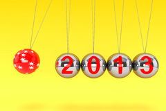 New Year Spheres of Newton. New Year concept. Spheres of Newton with 2013 on a yellow background Royalty Free Stock Image