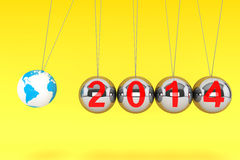 New Year Spheres of Newton. New Year concept. Spheres of Newton with Globe Earth and 2014 sign on a yellow background Royalty Free Stock Photo