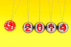 New Year Spheres of Newton. New Year concept. Spheres of Newton with 2014 on a yellow background Royalty Free Stock Photos