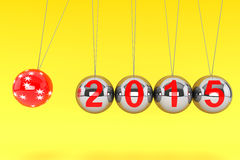 New Year Spheres of Newton. New Year concept. Spheres of Newton with 2015 on a yellow background Royalty Free Stock Photography