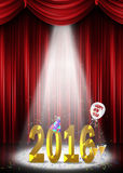 New Year 2016 in the spotlight. Gold 2016 New Year in the spotlight with confetti, hat and balloon Stock Image