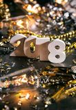 New Year: Staggared Numbers For 2018 NYE. A series celebrating New Year`s Eve, some with 2018 numerals.  Lots of confetti, champagne, etc. Good for backgrounds Royalty Free Stock Photo