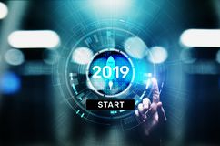 New year 2019 start button on virtual screen hologram. FInancial growth and new perspective in business and life. royalty free stock image