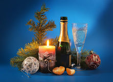New Year still life with a candle and champagne Stock Photography