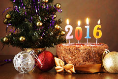 New Year 2016 still life. Chocolate cake and artificial fir tree Royalty Free Stock Images