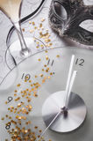 New year still life with clock and mask Royalty Free Stock Photo