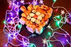 New Year Sushi. Beautiful food photo with Christmas garland. stock photo