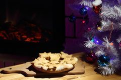 New Year sweets and a Christmas tree. Stock Photo