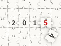 2015 New year symbol on puzzle. 2015 New year symbol on white puzzle Royalty Free Stock Image