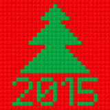 New Year symbols. New Year tree and 2015 in plastic construction kit texture on red Stock Images