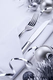 New Year table set. Silverware in napkin envelope on table decorated for christmas Royalty Free Stock Images