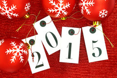 New year 2015 on tags and Christmas balls Royalty Free Stock Photography