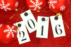 New year 2016 on tags and Christmas balls Royalty Free Stock Images
