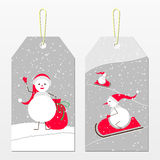 New year tags with snowmen. New year tags. Cute snowmen in red cap. Vector winter sport.  Snowmen with gifts and on snowmobiles. White snowmen on a bright snowy Stock Image