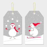 New year tags with snowmen. Skating cute snowmen in red cap. Vector winter sport. Cartoon skier and a juggler with snowballs. White snowmen on a bright snowy Royalty Free Stock Image