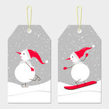 New year tags with snowmen. New year tags. Skating cute snowmen in red cap. Vector winter sport. Skating and skiing  snowmen. White snowmen on a bright snowy Stock Image