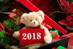 2018 new year with teddy bear and gifts Stock Photos