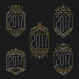 New Year 2017 text. Art deco frames in outline style. Badges in golden and white colors Royalty Free Stock Photography