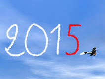 New year 2015 text from biplan smoke - 3D render. New year 2015 text from biplan smoke in blue sky - 3D render Stock Images