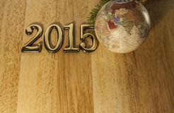 2015 New year text and Christmas Bauble. On the light wood Stock Images