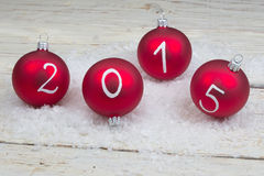 2015 New year text on christmas baubles Stock Images