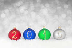 2015 New year text on christmas baubles Stock Image